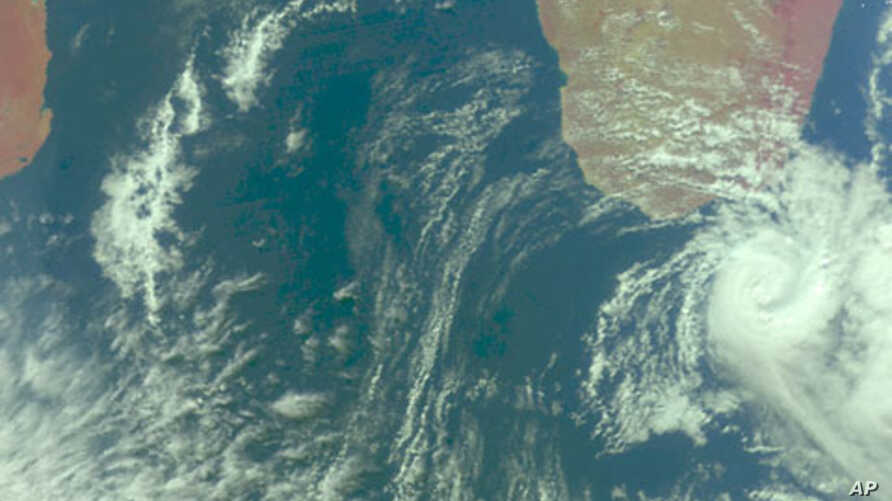 NASA's Aqua satellite captured a visible image of Subtropical Storm Joel (far right), southeast of Madagascar, just as it had strengthened enough to get its name, 28 May 2010