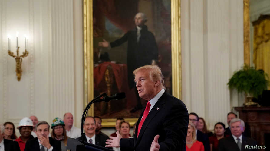 U.S. President Donald Trump speaks during a signing event for an Executive Order that establishes a National Council for the American Worker at the White House in Washington, U.S., July 19, 2018.