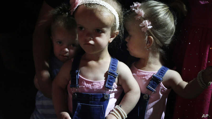 Children line up to participate in a Mr. and Ms. Dwarf competition during a weekend dwarf festival in Modimolle, South Africa, Friday, Sept. 8, 2017. The event this past weekend drew dwarves from around the country and was an opportunity to share exp