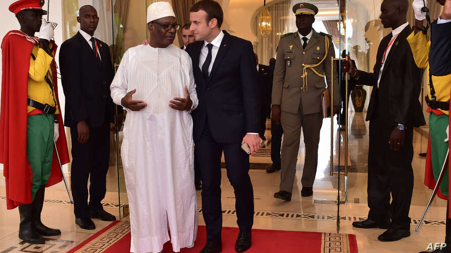French President Emmanuel Macron, right, walks next to Malian President Ibrahim Boubacar Keita during a G5 Sahel summit, in Bamako, on July 2, 2017, to boost Western backing for a regional anti-jihadist force for the Sahel region amid mounting insecu