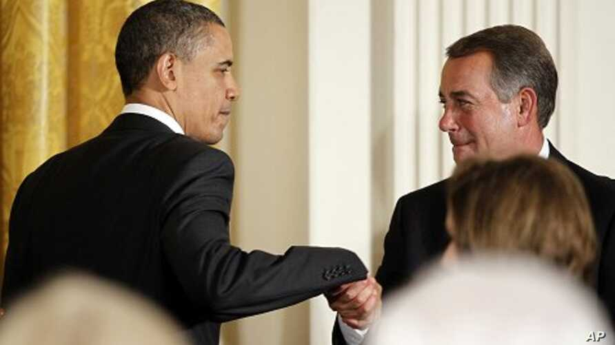 U.S. President Barack Obama greets House Speaker John Boehner before delivering remarks at a dinner of bipartisan committee chairmen and ranking members and their spouses at the White House, May 2, 2011