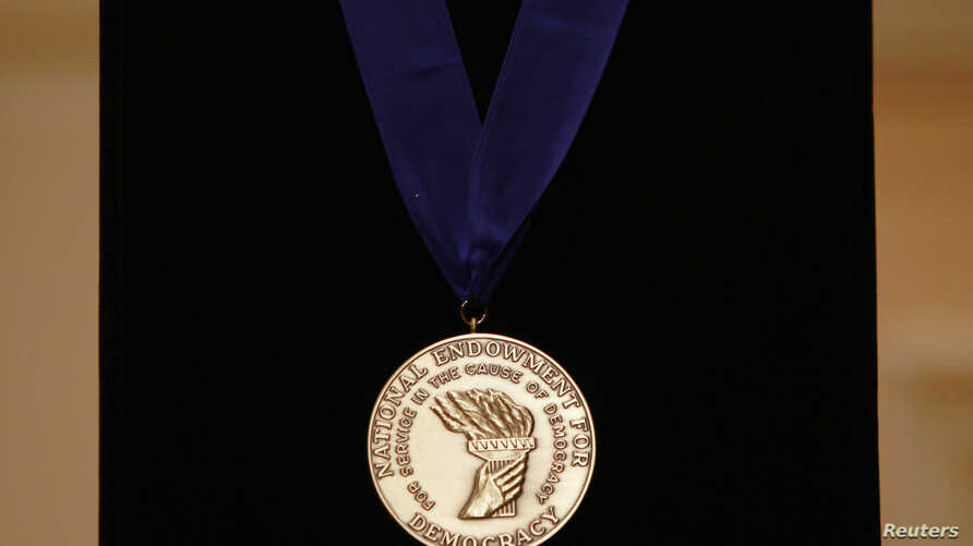 FILE - The National Endowment for Democracy's Democracy Service Medal is pictured at the Library of Congress in Washington.