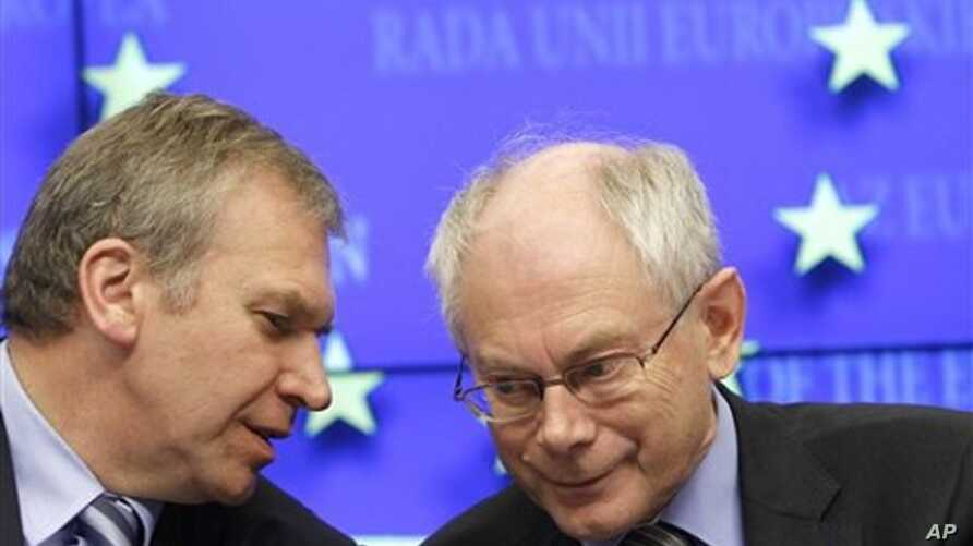 European Council President Herman Van Rompuy, right, speaks with Belgium's Prime Minister Yves Leterme during EU summit press conference in Brussels on 28 Oct. 2010.