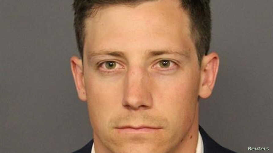 FILE - FBI agent Chase Bishop appears in a booking photo released by the Denver District Attorney's Office, in Denver, Colorado, June 12, 2018.