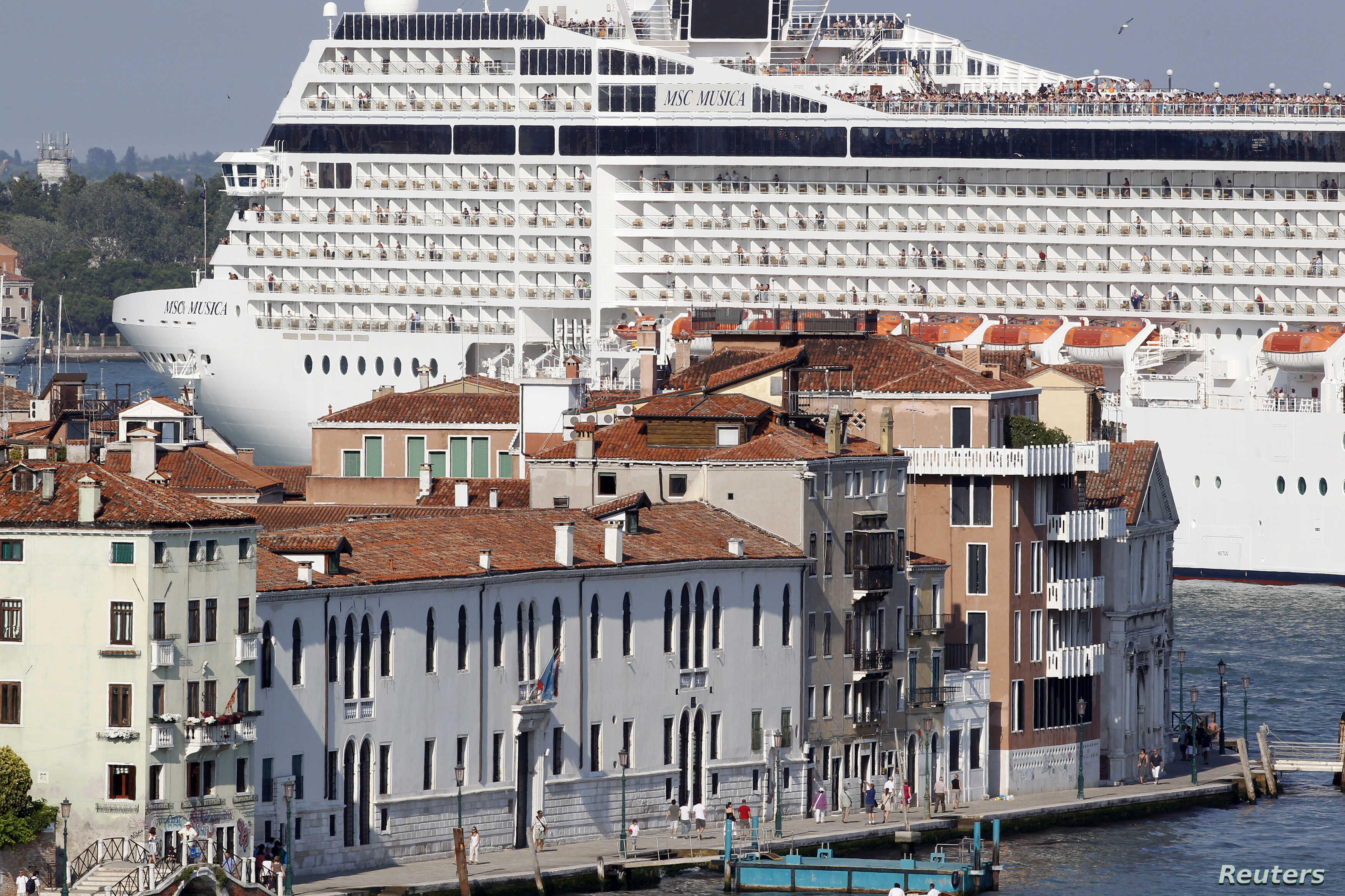 (File) The MSC Musica cruise ship in the Venice lagoon. Italy will now limit or shut down cruise ship traffic in parts of the Venice lagoon and near Saint Mark's Square.