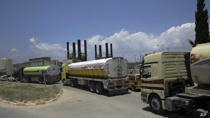 Egyptian trucks carrying fuel enter Gaza's power plant in the central Gaza Strip, June 21, 2017. Egypt on Wednesday trucked 1 million liters of cheap diesel to the Gaza Strip's sole power plant — a rare shipment that temporarily eased a crippling ele