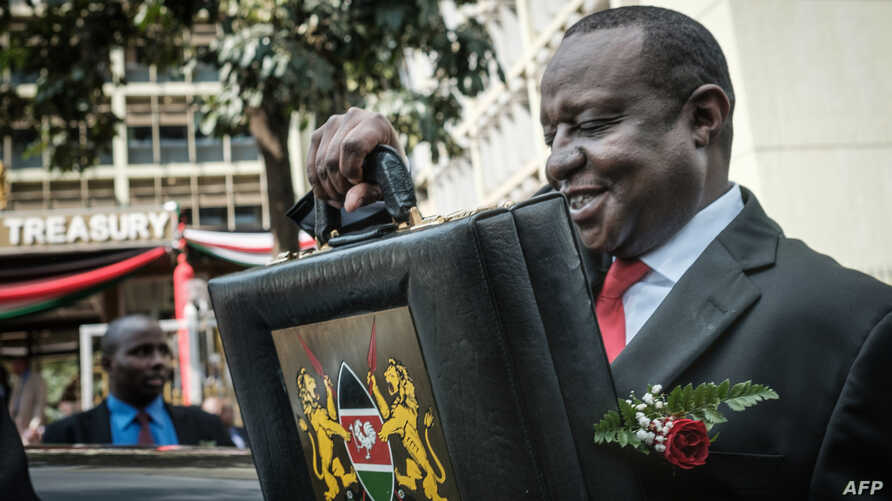 FILE - Kenya's Cabinet Secretary for National Treasury Henry Rotich leaves with the budget briefcase for Parliament to read the budget speech for 2018-2019 in Nairobi, Kenya, on June 14, 2018.