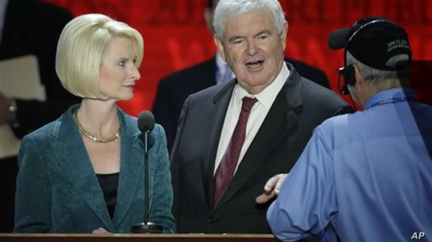 Former House Speaker Newt Gingrich and his wife Callista look over the podium during a sound check at the Republican National Convention in Tampa, Florida, August 28, 2012.
