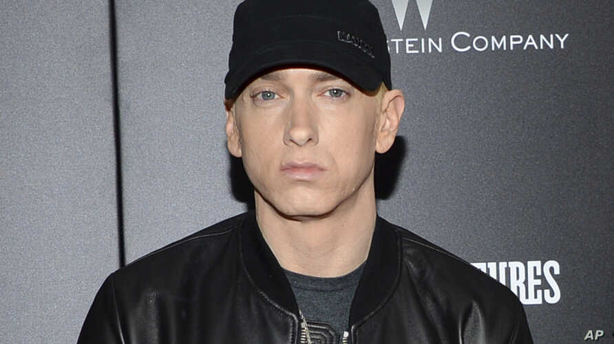 "Rapper Eminem attends the premiere of ""Southpaw"" in New York. Eminem, The Killers, Muse, Future, Bassnectar and Sturgill Simpson lead the lineup for the Bonnaroo Music and Arts Festival this June in Tennessee, July 20, 2015."