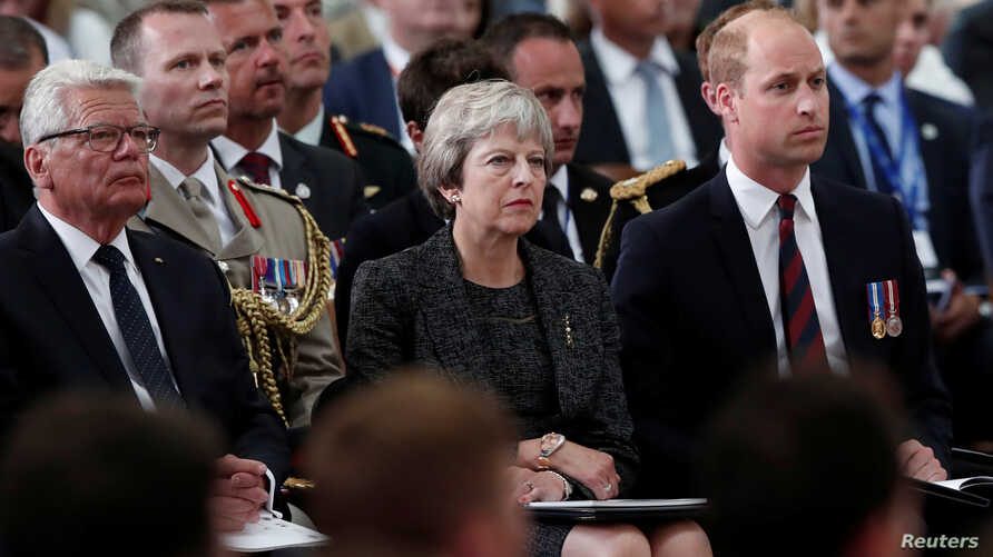 Britain's Prince William, Britain's PM Theresa May and former German President Joachim Gauck attend a religious ceremony to mark the 100th anniversary of the WW1 Battle of Amiens, at the Cathedral in Amiens, August 8, 2018,