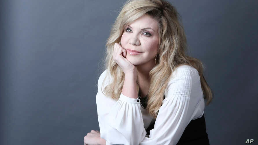 """Grammy Award-winning artist Alison Krauss poses for a portrait in New York to promote her solo album, """"Windy City,"""" Feb. 23, 2017."""