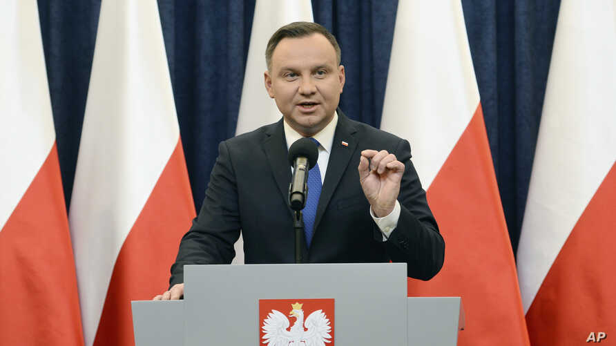 Polish President Andrzej Duda announces his decision to sign a legislation penalizing certain statements about the Holocaust, in Warsaw, Poland, Tuesday, Feb. 6, 2018. Duda said that he will also ask the constitutional court to make final ruling on t
