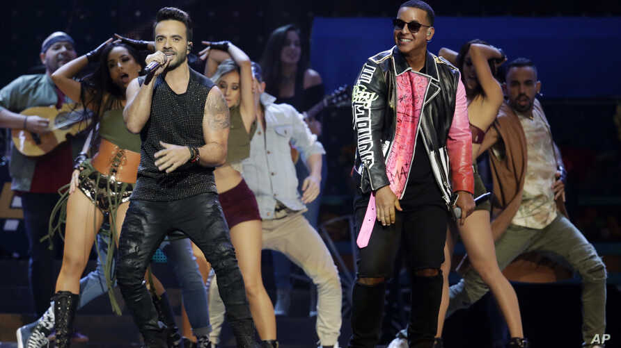 FILE -  Luis Fonsi, left and Daddy Yankee perform during the Latin Billboard Awards in Coral Gables, Fla.