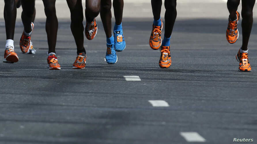 FILE - Runners are seen competing in a race.