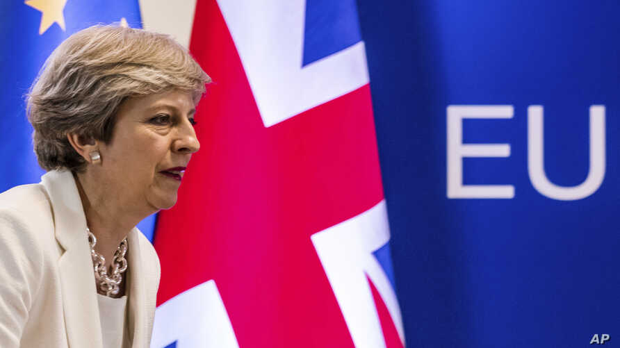 """FILE - British Prime Minister Theresa May prepares to address a media conference at an EU summit in Brussels, June 23, 2017. May appears to be looking into an EFTA membership as an alternative to a """"hard Brexit."""""""