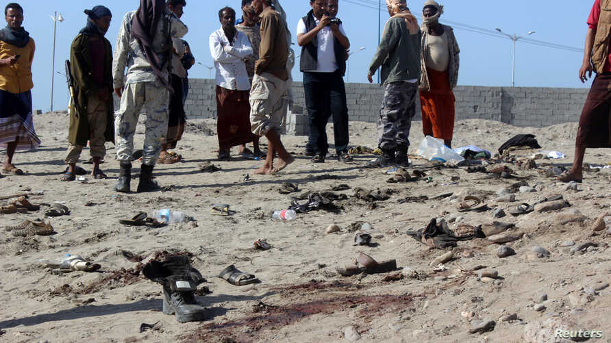 People gather at the site of a suicide bombing in the southern port city of Aden, Dec. 18, 2016.