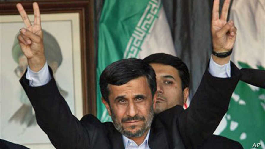 Iranian President Mahmoud Ahmadinejad flashes a V sign during a rally organized by Hezbollah in the southern border town of Bint Jbeil, Lebanon, 14 Oct 2010