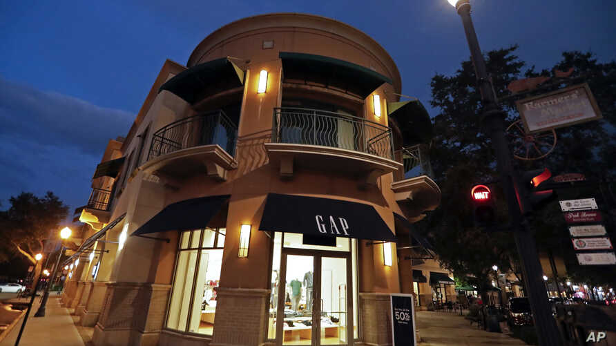 FILE -  A Gap clothing store is pictured in Winter Park, Fla., Aug. 23, 2018. Gap said Feb. 28, 2019, that it's creating two independent publicly traded companies — low-priced Old Navy and a yet-to-be named company that will consist of the iconic Gap