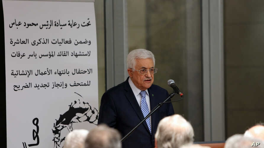FILE - Palestinian President Mahmoud Abbas speaks at the opening of a museum for late Palestinian leader Yasser Arafat in the West Bank city of Ramallah on Sunday, Nov. 9, 2014.