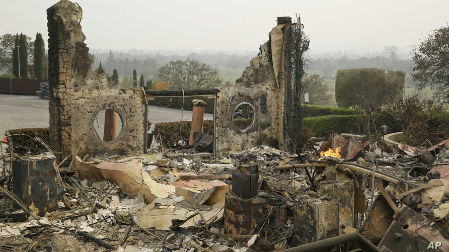 The remains of the Signorello Estate winery continue to smolder in Napa, Calif., Oct. 10, 2017.