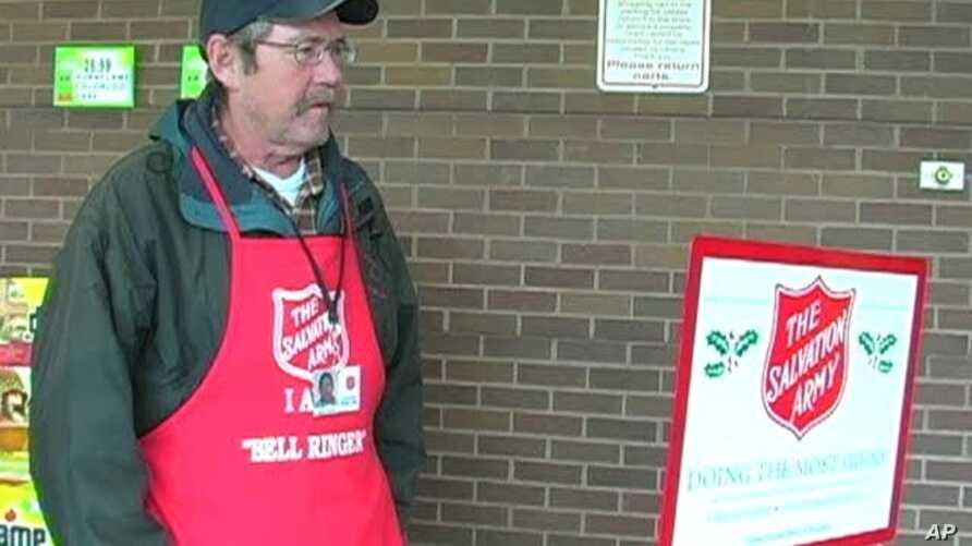 Lanny Green rings a bell to collect money for the Salvation Army outside a grocery store in Arlington, Virginia