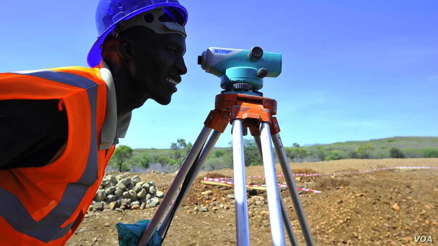 An engineer surveys the site of a power plant being built near Kenya's Lake Baringo. (Courtesy USAID)