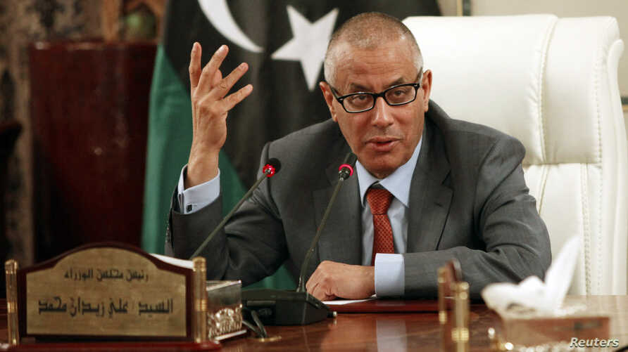 Libya's Prime Minister Ali Zeidan speaks during a joint news conference with Oil Minister Abdelbari al-Arusi at the Prime Minister's Office in Tripoli, July 2013.