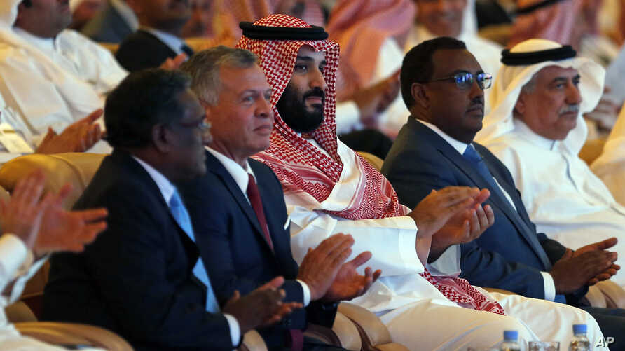 Saudi Crown Prince, Mohammed bin Salman, Jordan's King Abdullah II, and Ethiopia's Deputy PM Demeke Mekonnen, second right, attend the Future Investment Initiative conference, in Riyadh, Oct. 23, 2018.
