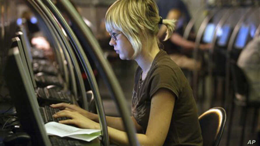 A Muscovite surfs a Web site at an Internet cafe in downtown Moscow (2006 file)