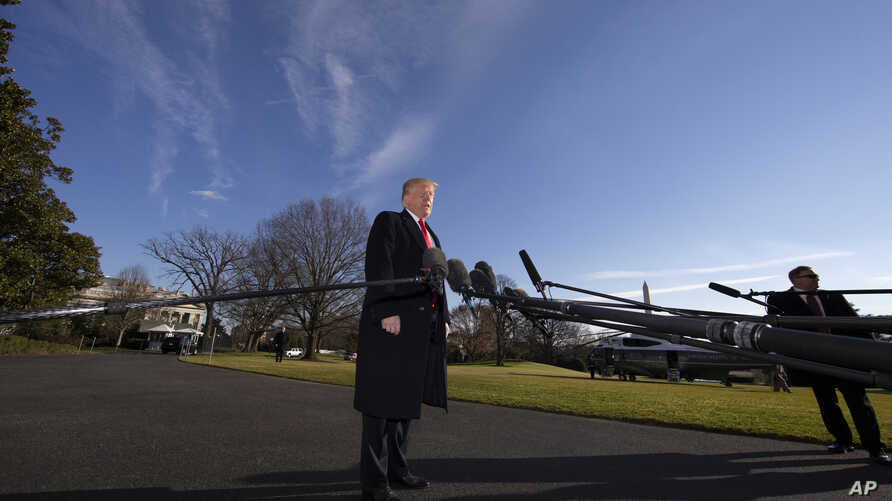 FILE - President Donald Trump speaks on the South Lawn of the White House with the presidential Marine One helicopter seen in the background, Jan. 6, 2019, in Washington.