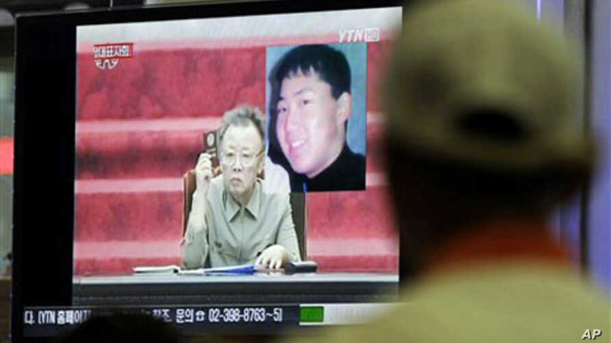 A South Korean man in Seoul watches a TV news program showing North Korean leader Kim Jong Il as he appointed youngest son, Kim Jong Un - shown in portrait at top right - as an army general in an apparent sign he is being groomed as country's next le
