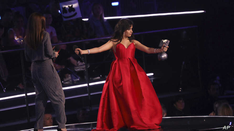 Singer Camila Cabello accepts the Best Artist award during the European MTV Awards in Bilbao, Spain, Sunday, Nov. 4, 2018.