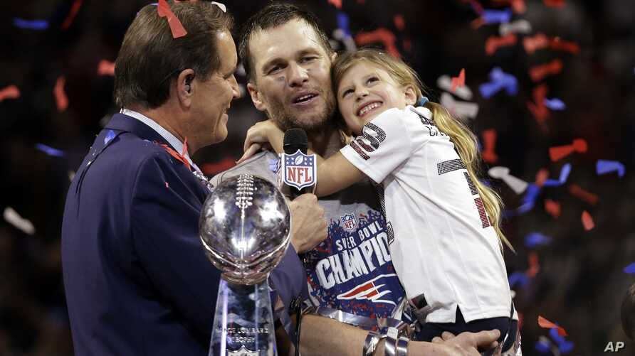 New England Patriots' Tom Brady holds his daughter, Vivian, after the NFL Super Bowl 53 football game against the Los Angeles Rams, Sunday, Feb. 3, 2019, in Atlanta.