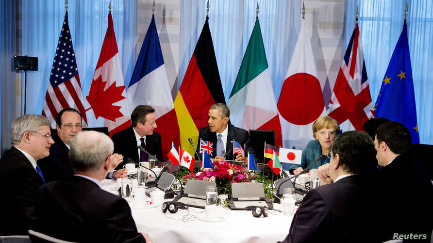 FILE - President Barack Obama (C) participates in a G7 leaders meeting during the Nuclear Security Summit in The Hague March 24, 2014.