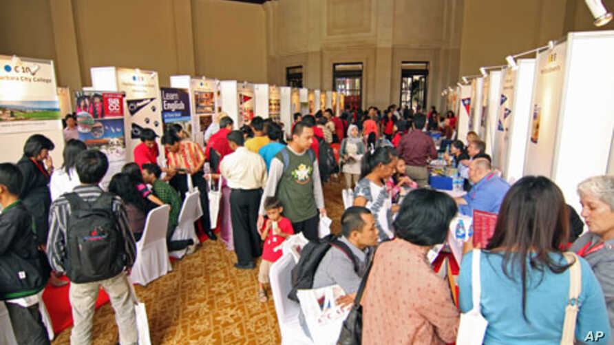 Students visit recruiters from US universities seeking answers to questions about studying abroad, at a US education fair sponsored by the US Embassy in Jakarta, April 4, 2011