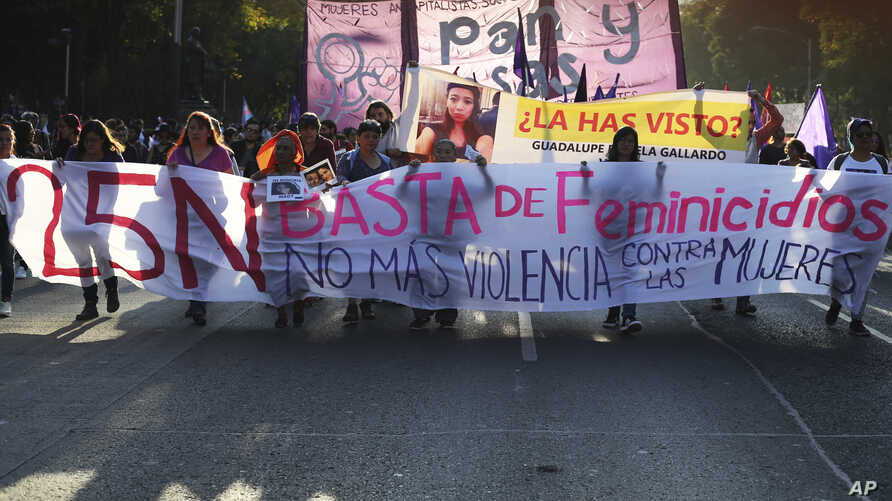 Women march to mark the International Day for the Elimination of Violence against Women, in Mexico City, Nov. 25, 2017