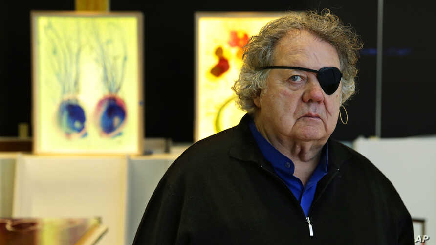 Glass artist Dale Chihuly poses for a photo in one of his studios in Seattle, March 22, 2017.
