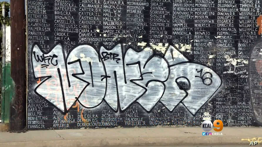 Graffiti is shown on a Vietnam War memorial in the Venice area of Los Angeles, May 27, 2016. The memorial lists the names of American service members missing in action or unaccounted for in Southeast Asia, painted by a Vietnam veteran and dedicated i