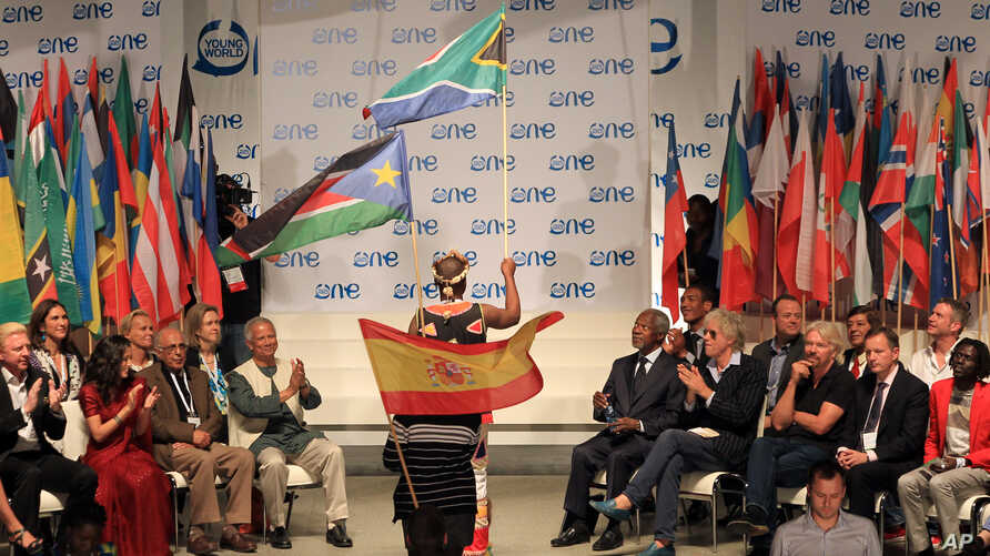 Youth delegates hold their national flags during the opening ceremony for the One Young World summit at Soccer City in Johannesburg, South Africa, Oct. 2, 2013.