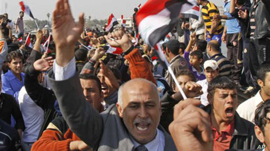 Protesters chant anti-government slogans during a demonstration against the lack of basic services in Basra, Iraq's second-largest city, 550 kilometers (340 miles) southeast of Baghdad, February 18, 2011