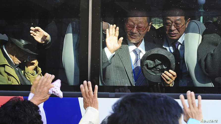 South Koreans on a bus bid farewell to their North Korean relatives after temporary family reunions at Mount Kumgang resort in North Korea, in this November 5, 2010, file photo.