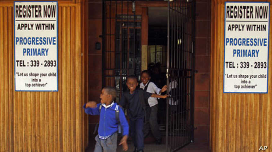 Students run out of the main door as they leave the Progressive Primary in Johannesburg (2010 file photo). Progressive Primary is among an increasing number of such schools for poor South Africans underserved by a government that has struggled to clo