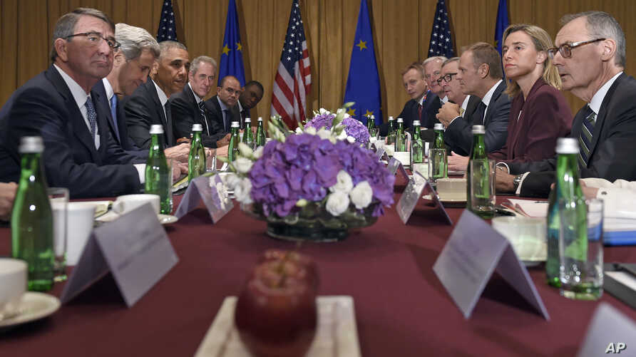 U.S. President Barack Obama, third from left, meets with European Council President Donald Tusk, third from right, and the President of the European Commission Jean-Claude Juncker, fourth from right, in Warsaw, Poland, July 8, 2016.