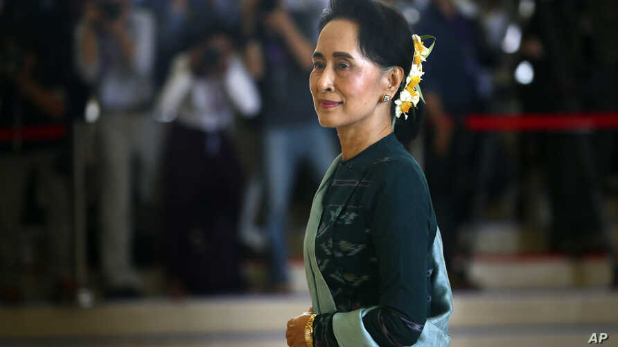 FILE - In this March 15, 2016 file photo, National League for Democracy party (NLD) leader Aung San Suu Kyi arrives in Manama's parliament in Naypyitaw, Myanmar. Aung San Suu Kyi starred as arguably the world's most prominent and revered political pr