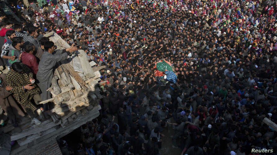 Kashmiri villagers carry body of rebel Sahir Ahmed, during his funeral procession in Arwani, 55 kilometers (35 miles) south of Srinagar, Indian controlled Kashmir, Oct. 26, 2018.