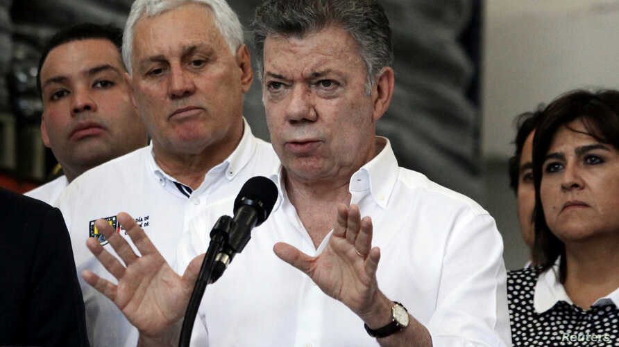 Colombia's President Juan Manuel Santos talks to reporters after a meeting with regional authorities in Cucuta, Colombia, Feb. 8, 2018.