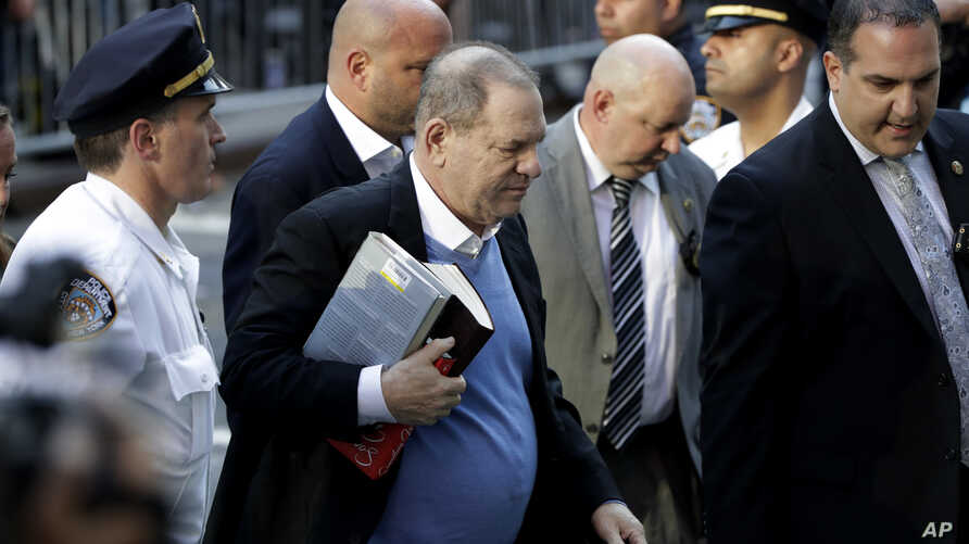 Harvey Weinstein arrives at the first precinct while turning himself to authorities following allegations of sexual misconduct, May 25, 2018, in New York.