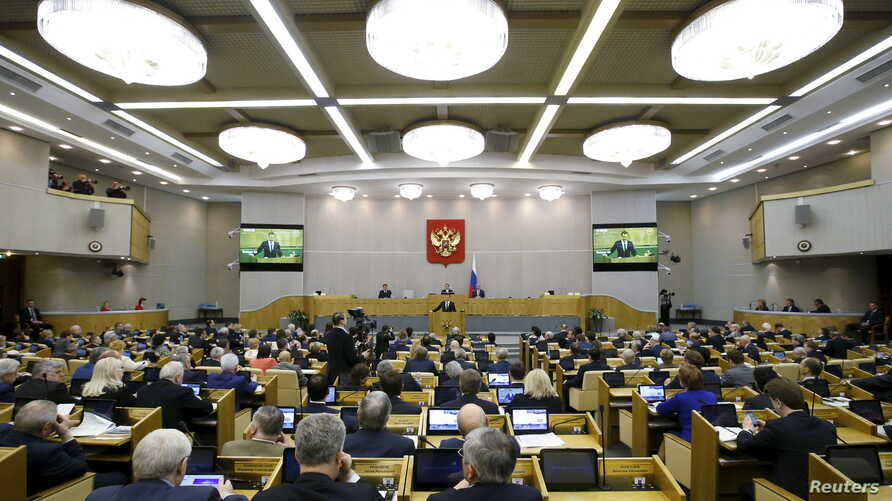 FILE - Duma members listen to Russian Prime Minister Dmitry Medvedev who delivers a speech during a session at the State Duma, the lower house of parliament, in Moscow.