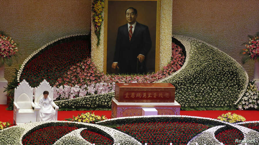 Han Hak-ja, widow of Evangelist Reverend Sun-Myung Moon, sits beside the coffin of Moon, founder of the Unification Church, during a funeral service at the CheongShim Peace World Center in Gapyeong, about 60 km (37 miles) northeast of Seoul, South Ko