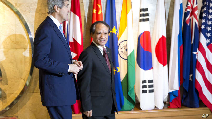 Secretary of State John Kerry, left, walks with Secretary-General of Association of Southeast Asian Nations (ASEAN), Le Luong Minh to their meeting on Sunday, Feb. 16, 2014, in Jakarta, Indonesia.